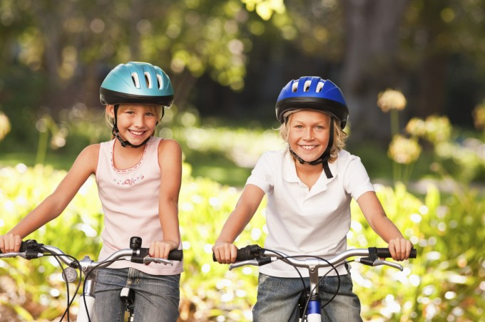 two young girls with their bicycles