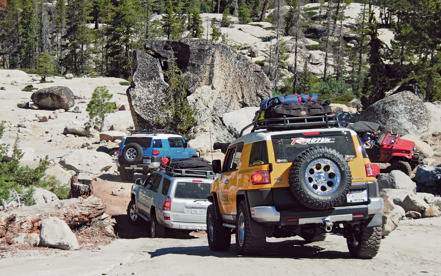 several jeeps traveling together on off road route
