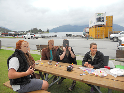 Friends celebrated the Wrangell Bear Fest by making their own bear masks. Photo by Corree Delabrue.
