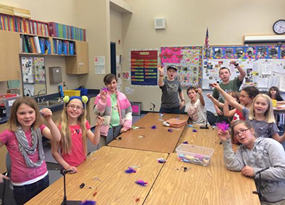 Students in the Coho in the Classroom program make fly ties.