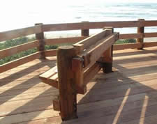 Viewing platform with wooden bench looking facing toward the Pacific Ocean