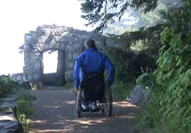 Heading up Whispering Spruce Trail in a wheelchair towards the rock shelter