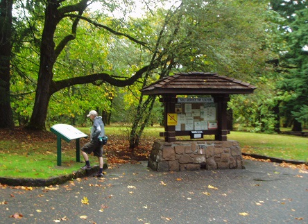 Visitor reads the interpretive sign at Wyeth Campground