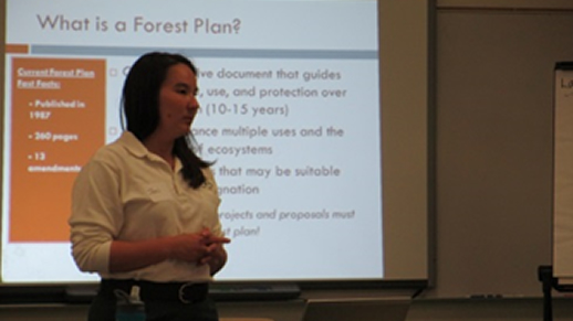 Forest Planner Jennifer Cramer gives a presentation about the Forest Plan Revision process.