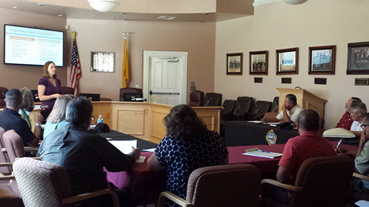 Forest Plan Revision Team member Shannon Kelardy gives a presentation at a Rio Arriba County Commissioners meeting.