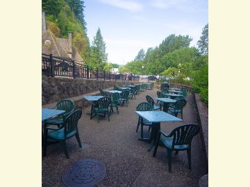 Outdoor seating area at Multnomah Falls, separate from restaurant seating.
