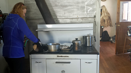 Cooking on the cook stove at Warm River cabin