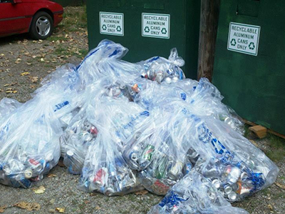 Pile of aluminum cans collected near the river to be recycled.
