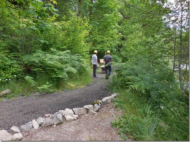 Living Legacy Trail with new compacted gravel surface and two workers standing in distance.