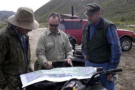 3 guys looking at a map