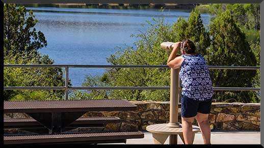 Wildlife viewing scope allows visitors to focus on birds and animals around the lake