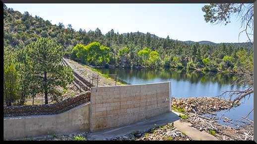 Unpaved trail crosses the dam at Lynx Lake