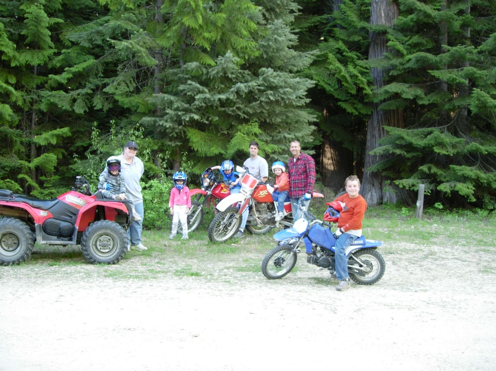 A group of ATV and dirt bike riders