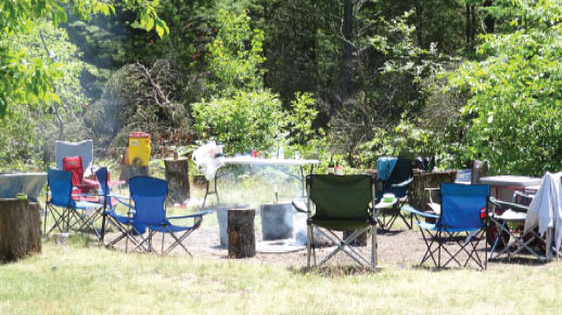 River Dune Campground – a smoking campfire left unattended on the Au Sable River.