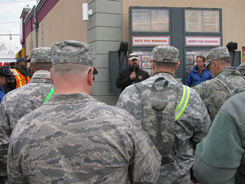 Cody Peel giving a welfare briefing to other people assigned to the disaster.