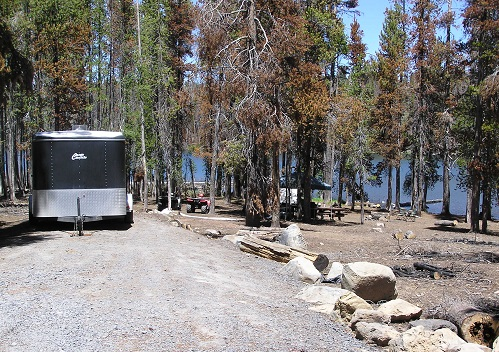 Dry campsite near a blue Deadhorse Lake
