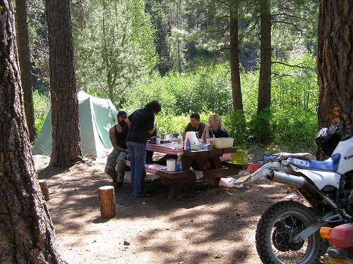 Visitors gather at a picnic table at Clear Springs Campground.