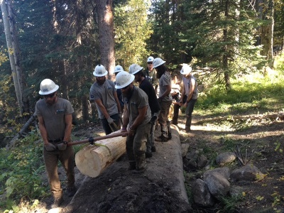 Rocky Mountain Youth Corp working together to build a bridge in the Indian Peaks Wilderness.