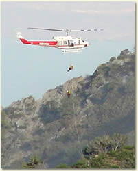 photo of firefighters rapelling out of helicopter