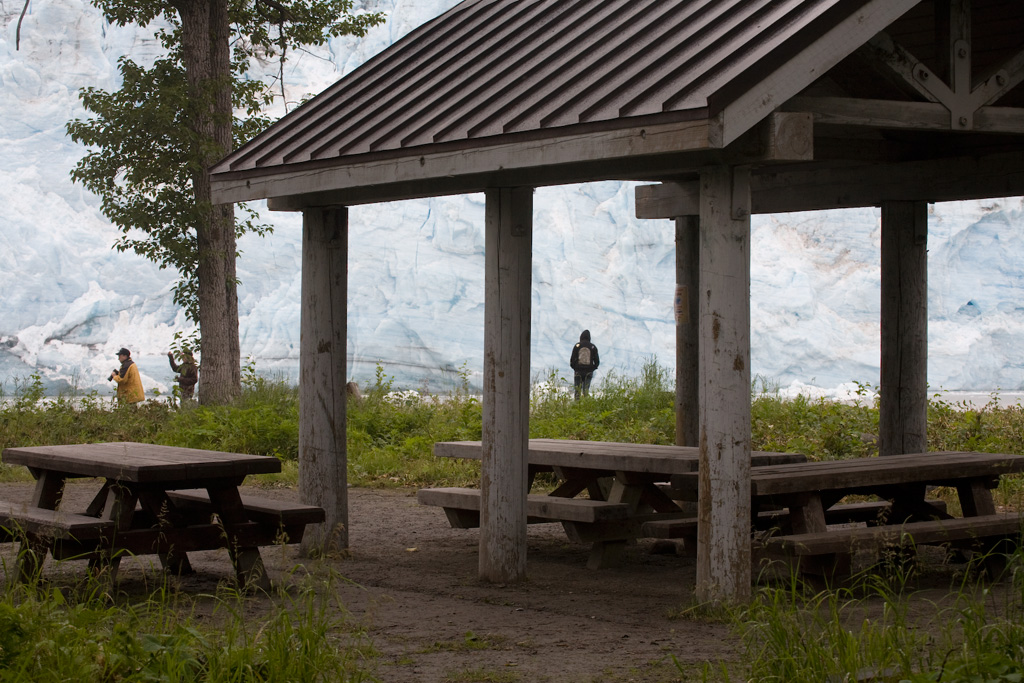 Looking through the picnic area shelter to the wall of Childs Glacier across the river