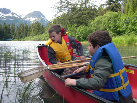 Kids canoeing and looking for bugs in Cordova Alaska - photo by USFS Kim Kiml