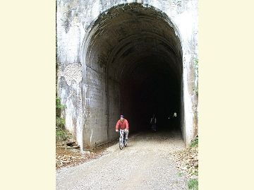 Photo of a biker emerging from a tunnel