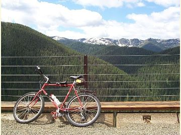 Photo of a bike and a vista that includes Shefoot Mountain in the distance.