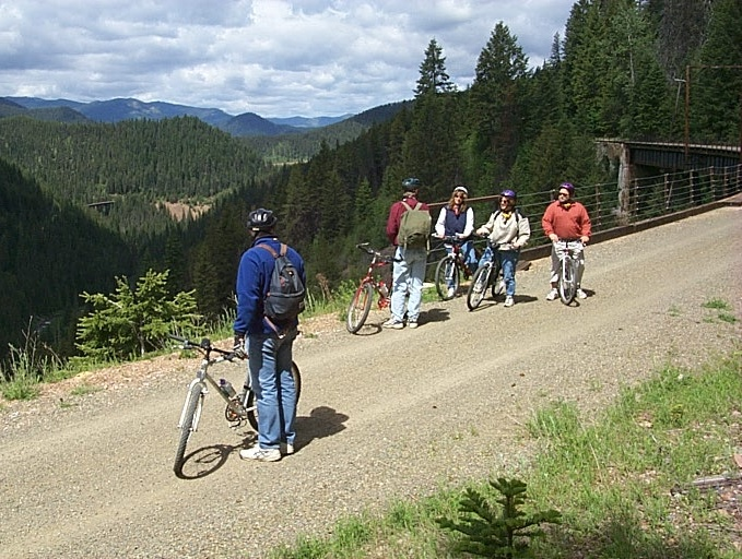 Photo of riders looking at scenery along the trail.