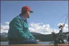 Photo of an angler in a boat trolling for trout on Priest Lake