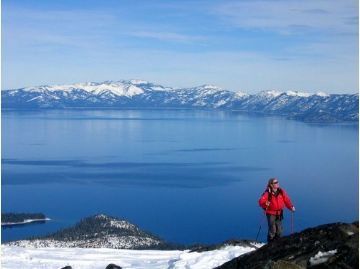 photo of person cresting at the top of Tallac