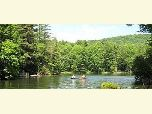 Photo of two boats on Lake Conasauga with people boating and fishing.