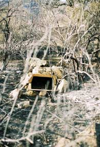 [Photograph]: Lower outlet of guzzler; before the fire it was not seen due to the dense brush covering it.