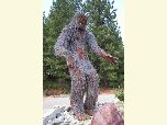 Tall metal sculpture of Bigfoot stands 16 ft tall along the highway at Happy Camp