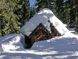 Gold Lake Shelter with deep snow on roof from winter 2006