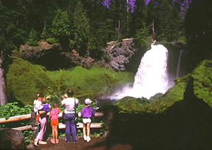 People standing on overlook with Sahalie Falls in background