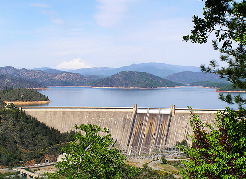 photo looking at Shasta dam with Shasta Lake and Mt. Shasta in the background