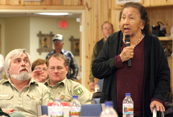 An American Indian woman speaks to the crowd at a tribal relations meeting