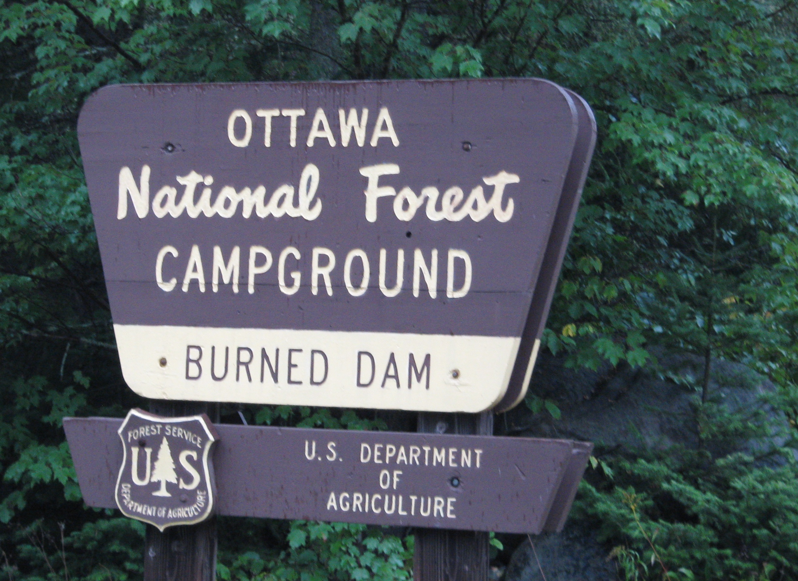 Campground Sign Burned Dam