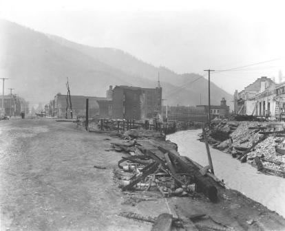 R.H. McKay, 1910; end of fire line near main business district in Wallace, ID.