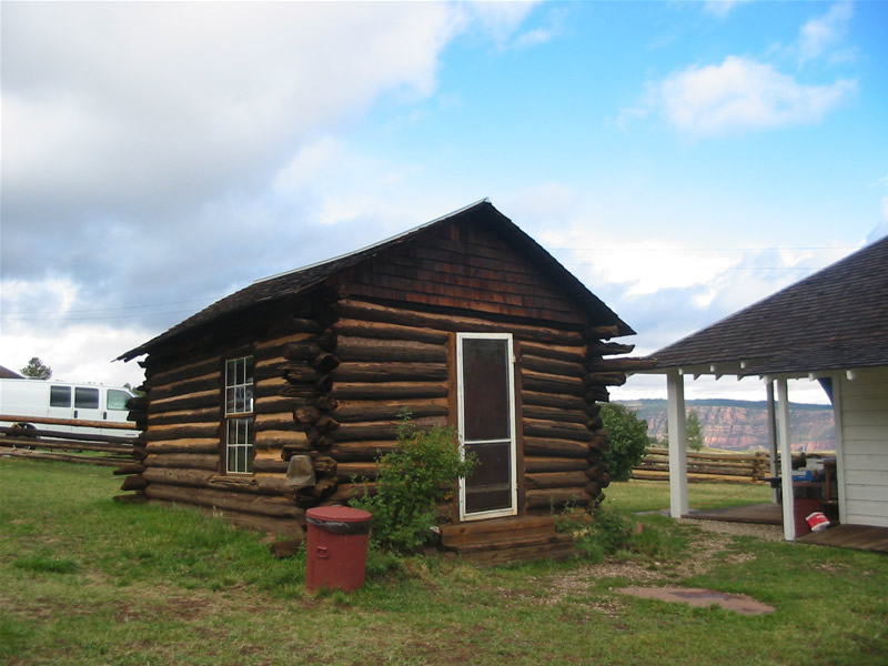 Photo showing the present day view of the exterior of the one-room cabin.