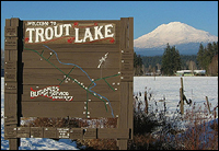 Welcome to Trout Lake, photo of welcome sign and Mount Adams in the background