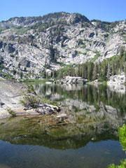 A photo of a Mountain range reflected in the water of Snow Lake, Desolation Wilderness.