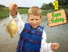 Boy holding a small fish and gone fishign sign