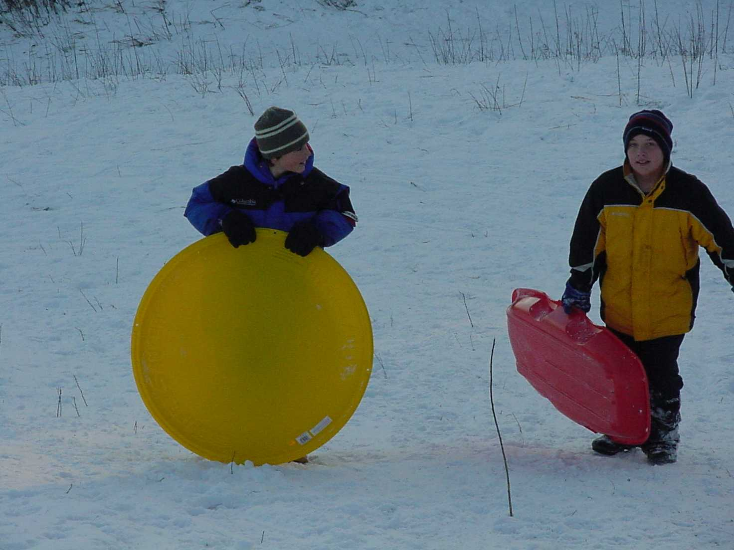 2 boys carry their sleds at shingobee hills