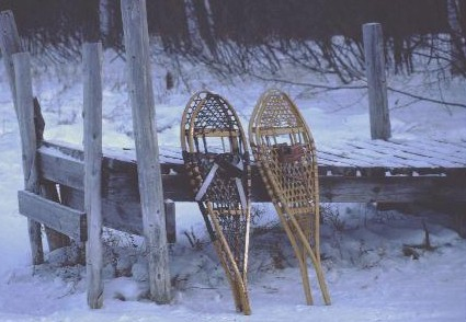 Snowshoes leaning up against a dock