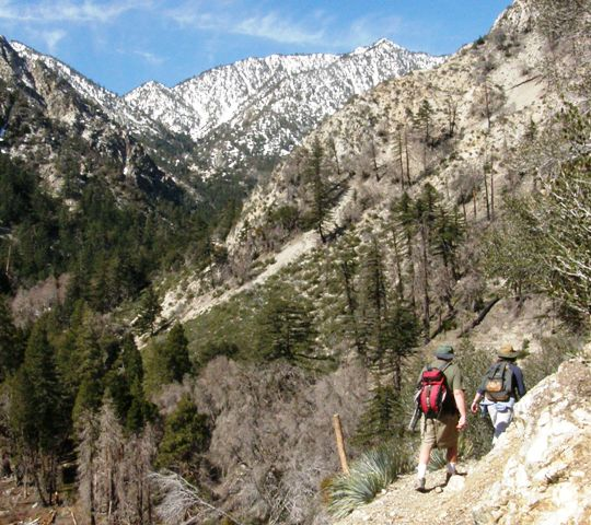 Hikers on Middle Fork Trail in the Cucamonga Wilderness with rugged mountain scenery all around them
