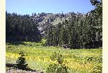 [Photograph]:  Northwest face of Mt. Linn with meadow in foreground.