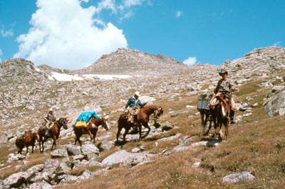 Photo of People Riding Horses on Mountain