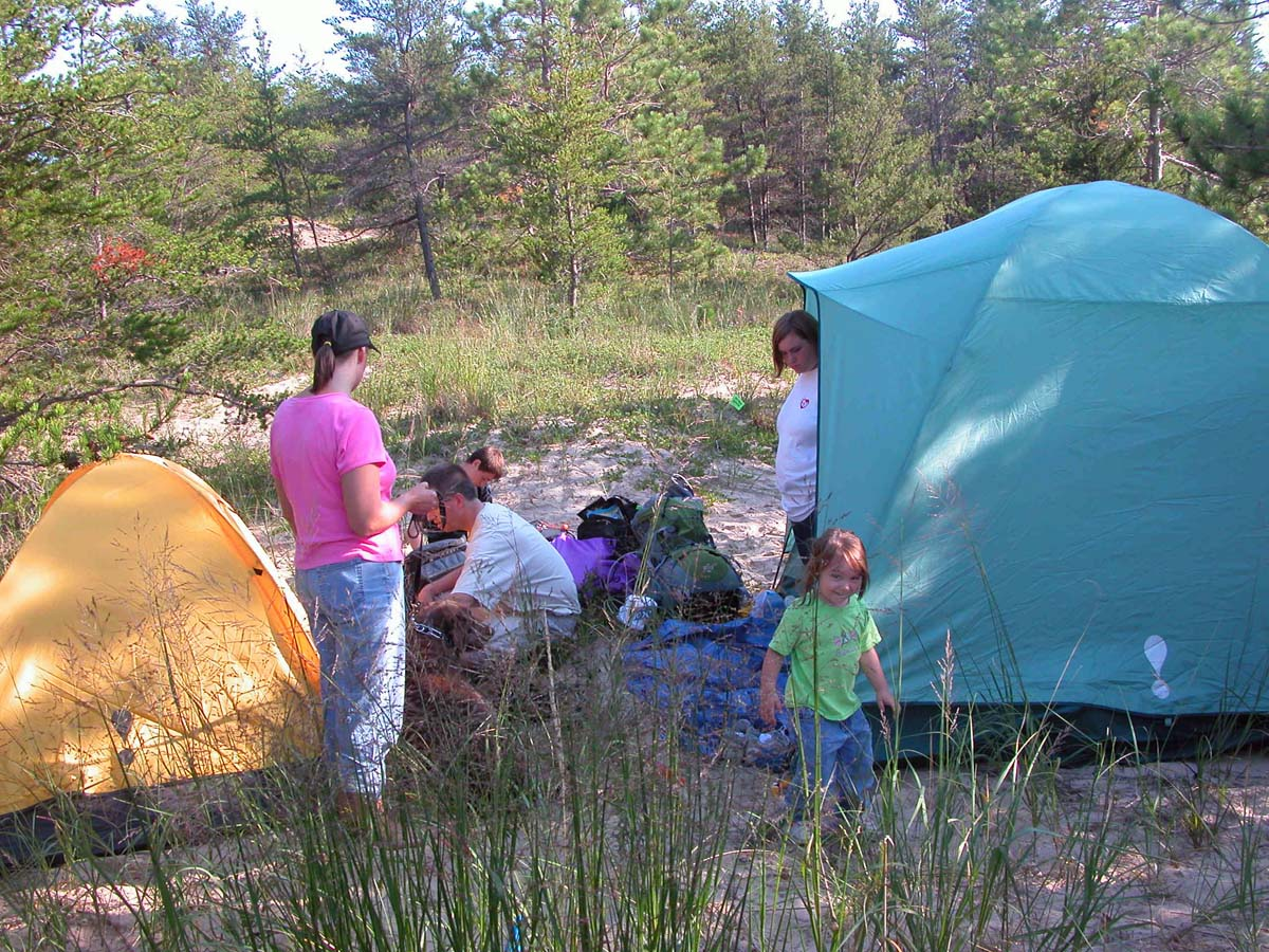 A family camping within the Nordhouse Dunes Wilderness Area.