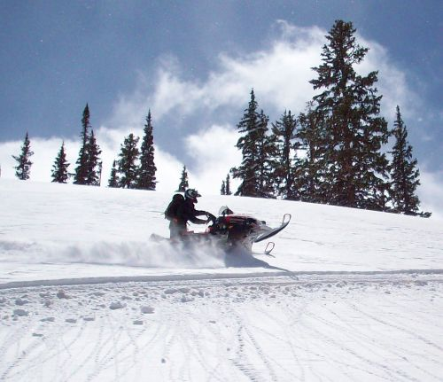 Snowmobile on side of mt